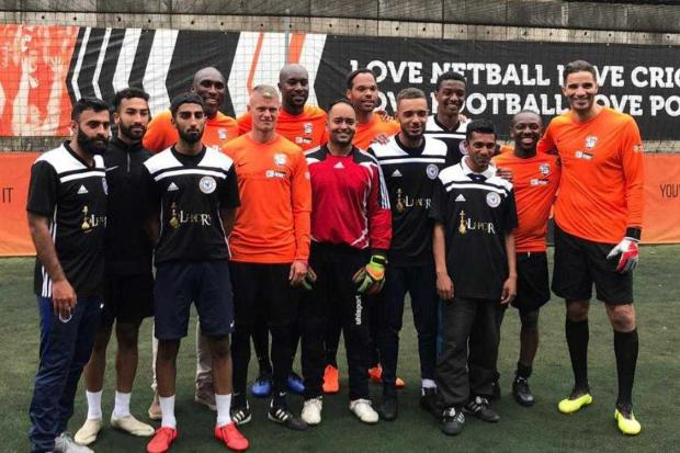 Slough Scorpionz (black and white) with the team of former professionals (orange) after winning the inaugural Bet Regret Cup in London.