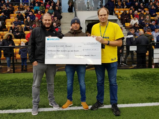 The Slough Town Supporters Trust present a cheque for £1,310 Sponsored Walk to Haybrook College Pit Stop Project. PHOTO: Gary House.