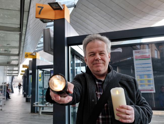 (191128) Jphn McKeown in Slough Bus Station with his torch and candle after broken lights are failed to be repaired by Slough Council. Pitures by Mike Swift.