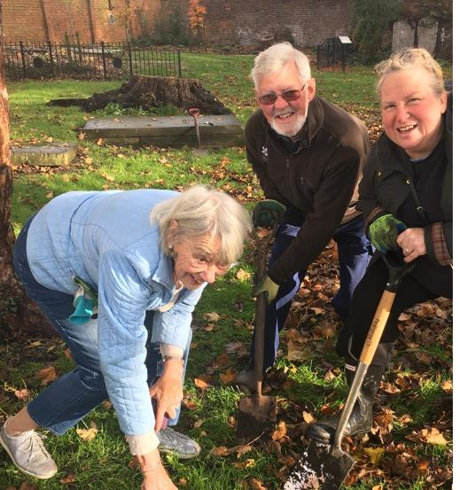 Anne Taylor ( chairman of Windsor and Eton Society's Heritage and Environment Committee  with fellow members Andrew Melville and Susy Shearer in the act of planting