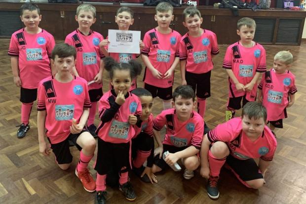 Young children in pink Confidence Through Football kits.