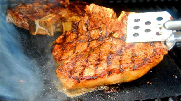 Slough Observer: A barbecue mat is perfect for sticky foods—or things that might fall through the grates. Credit: Amazon / Kona