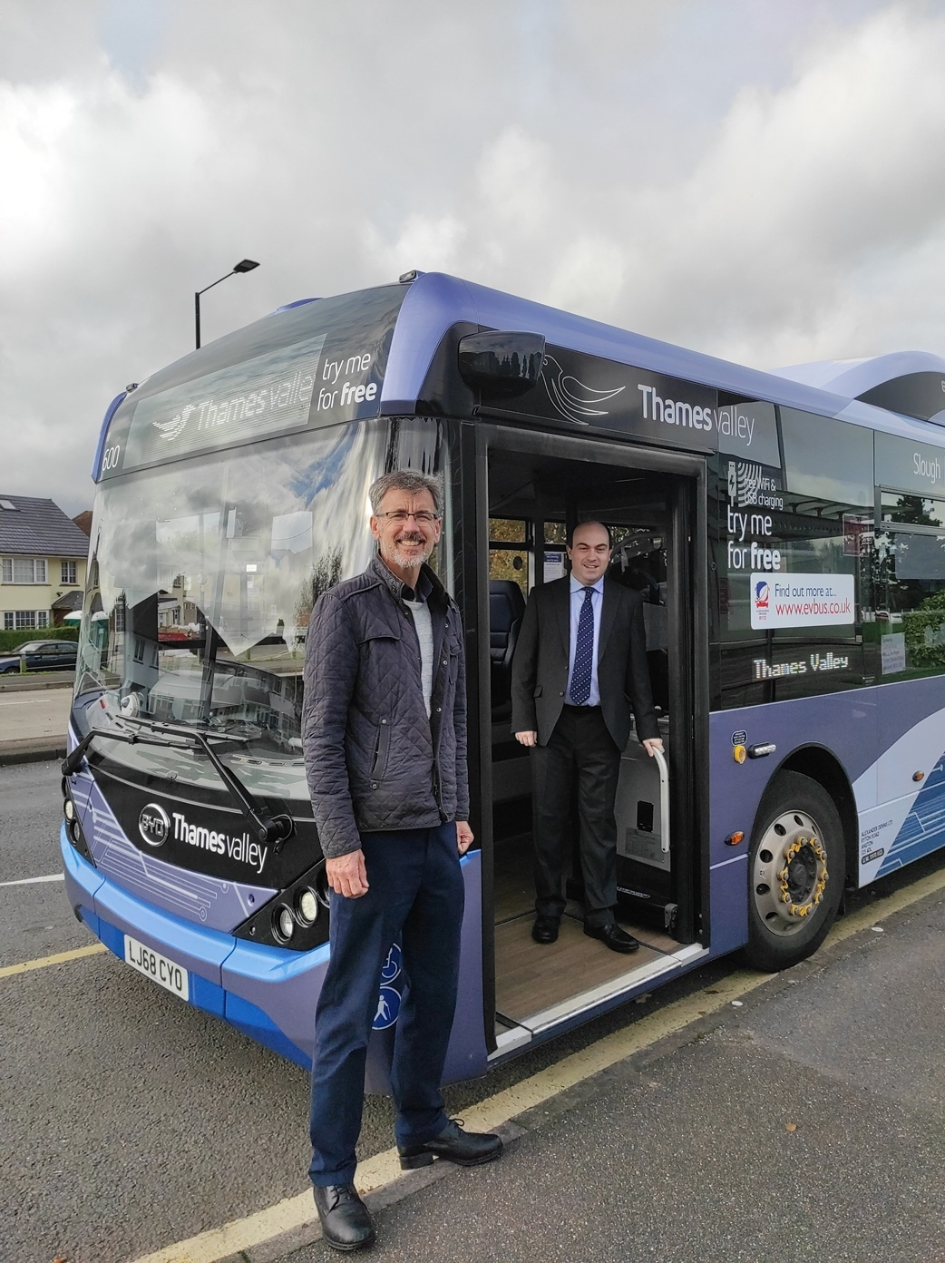 Cllr Rob Anderson in front of an electric bus