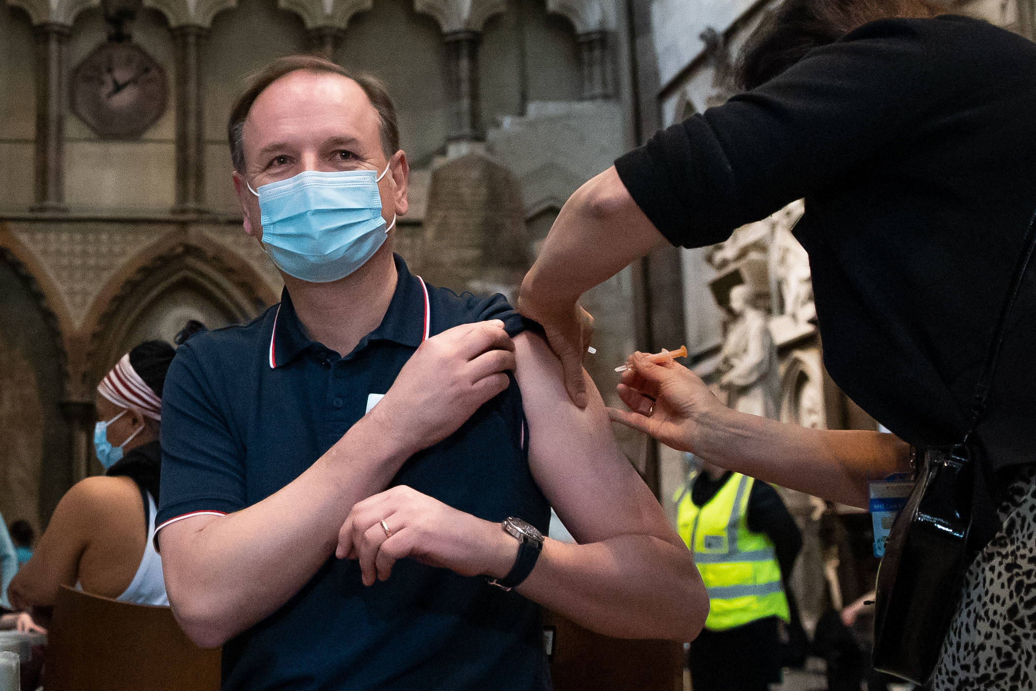 Dr Jan Maniera local GP and clinical director for south Westminster primary care network administers an injection of the Astra Zeneca coronavirus vaccine to Chief Executive of the National Health Service Sir Simon Stevens at Westminster Abbey, London.
