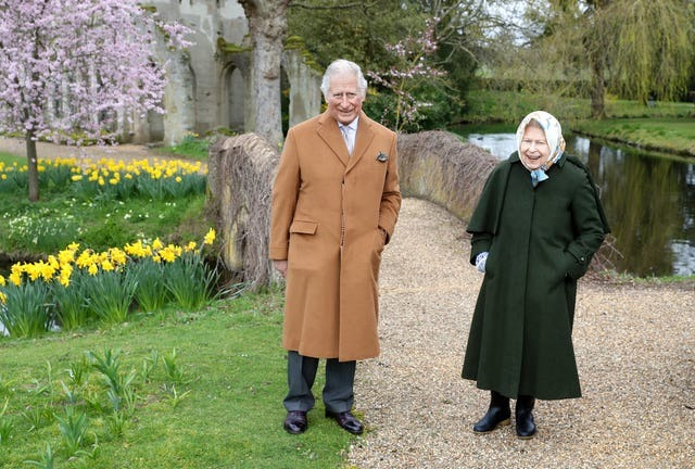 The Queen and her eldest son smiled as they walked around the grounds of Frogmore House (Chris Jackson/PA)
