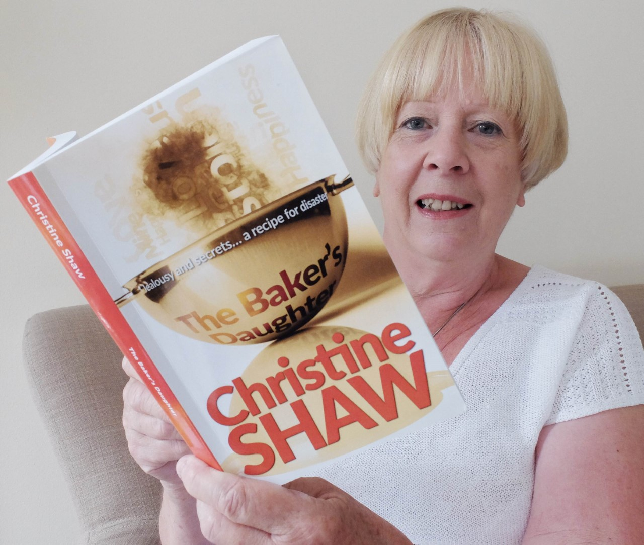 Christine Shaw with her newly published novel. Photo: Mike Swift