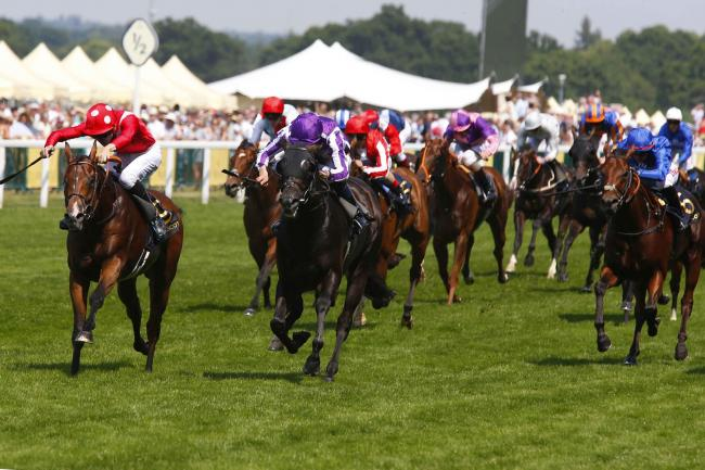 Le Brivido (red) storms to victory in the Jersey Stakes. All pictures by Sue Orpwood.