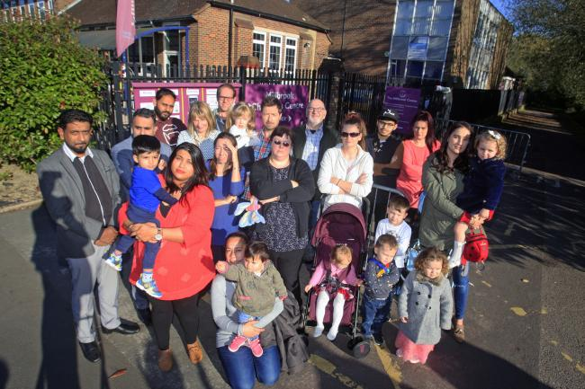 Millbrook Children's Centre protest, with Alka Dass, in red and holding child