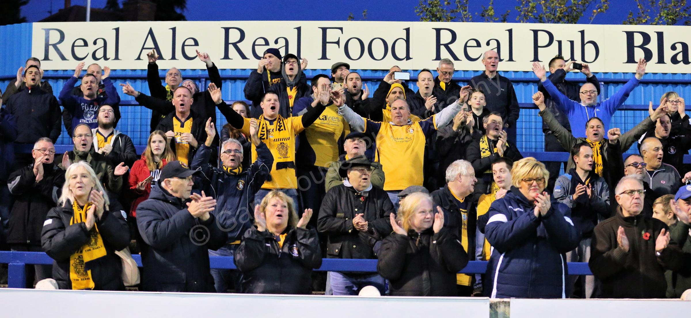 Slough Town supporters cheer on their side to victory at Gainsborough Trinity in the FA Cup first round. PHOTO: Gary House Photography.