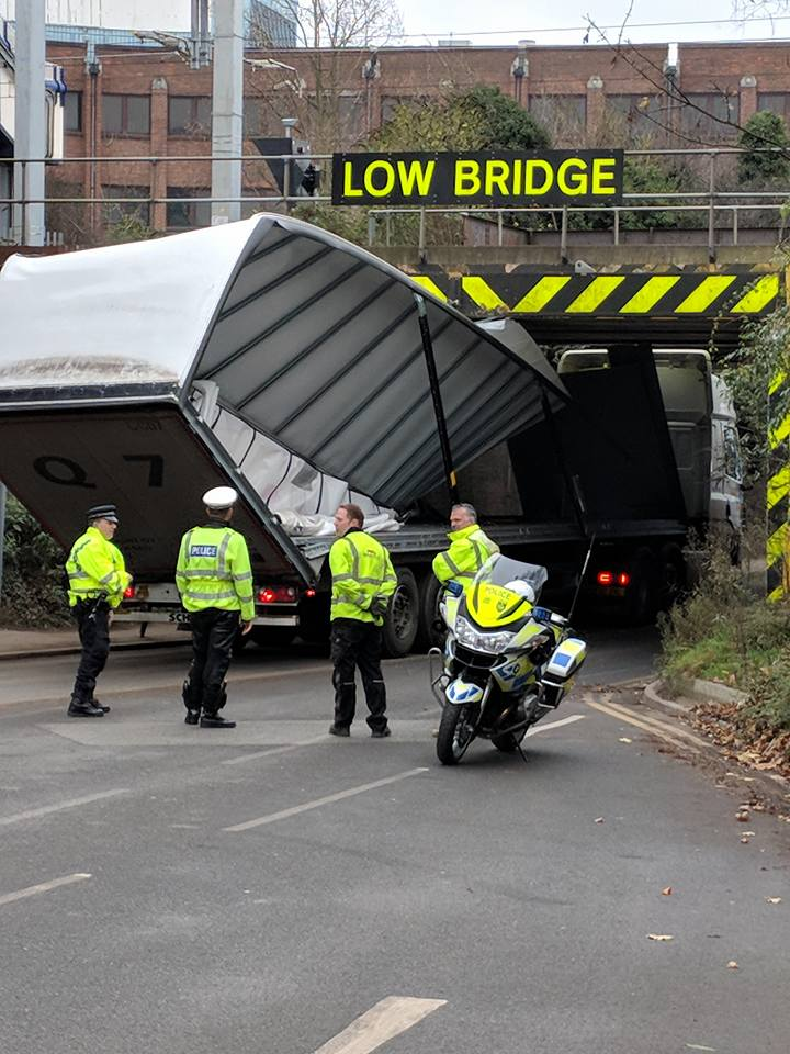 The lorry became wedged under Langley Station Bridge at approximately noon today. Photo: Mario Van Poppel