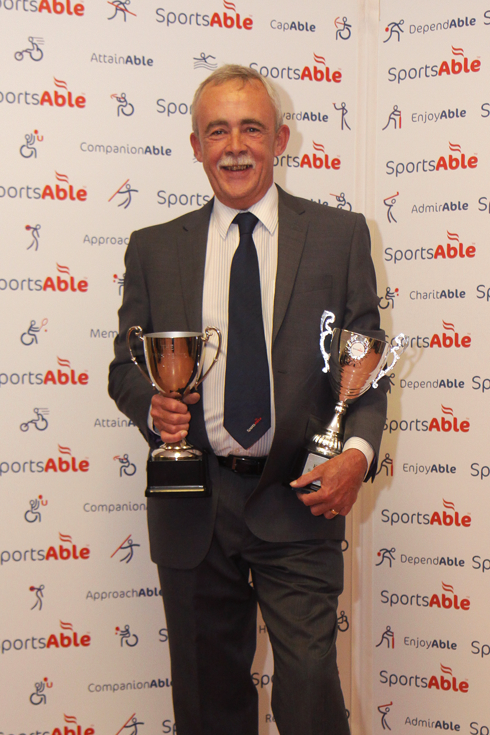 Mr Gibbs with the president's cup he won at the 2016 SportsAble award evening