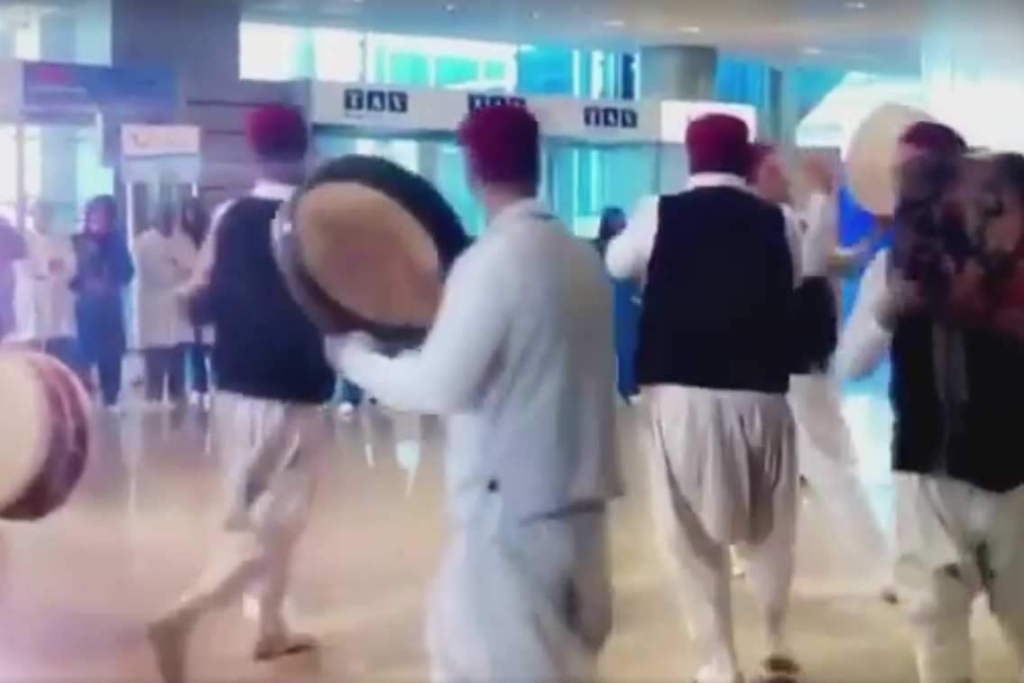 A band playing music and dancing greet the first British flight to Tunisia since the 2015 terror attacks.