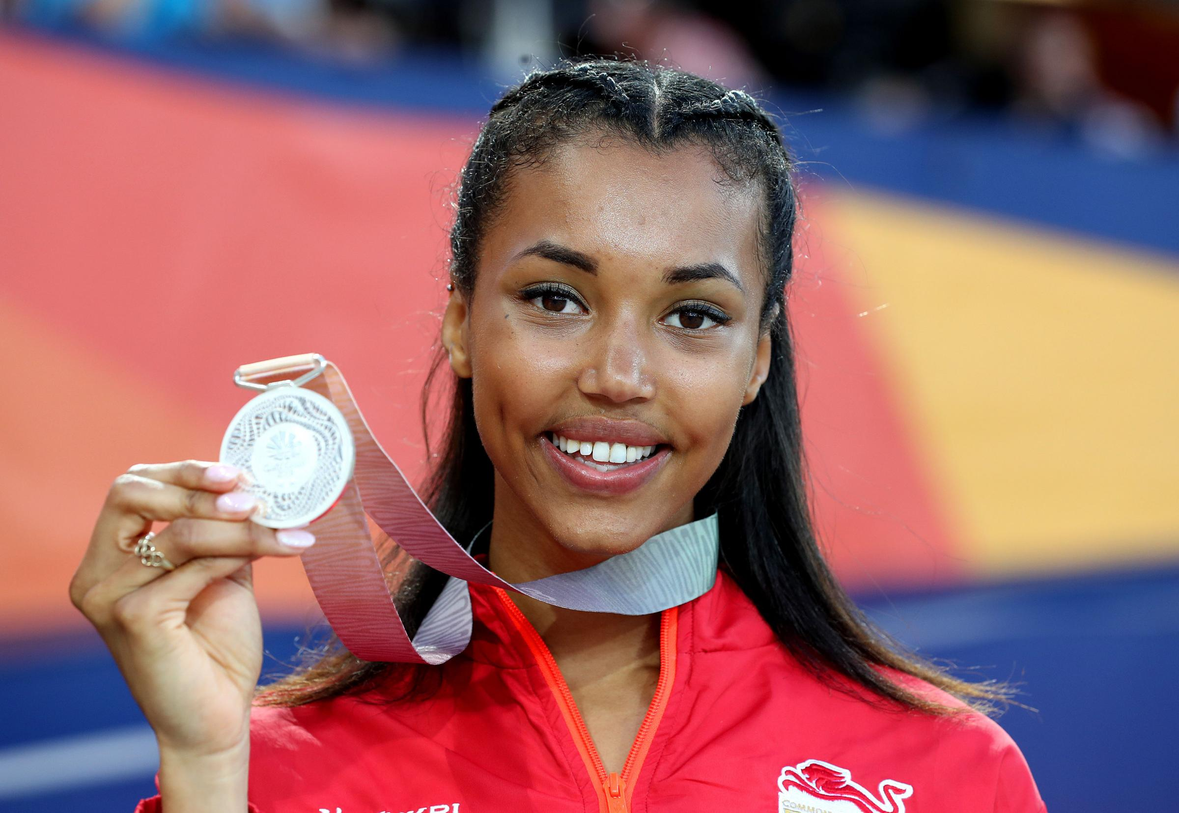 England and WSEH Athletics Club star Morgan Lake celebrates with the silver medal won in the high jump at the Commonwealth Games. Martin Rickett/PA Wire.