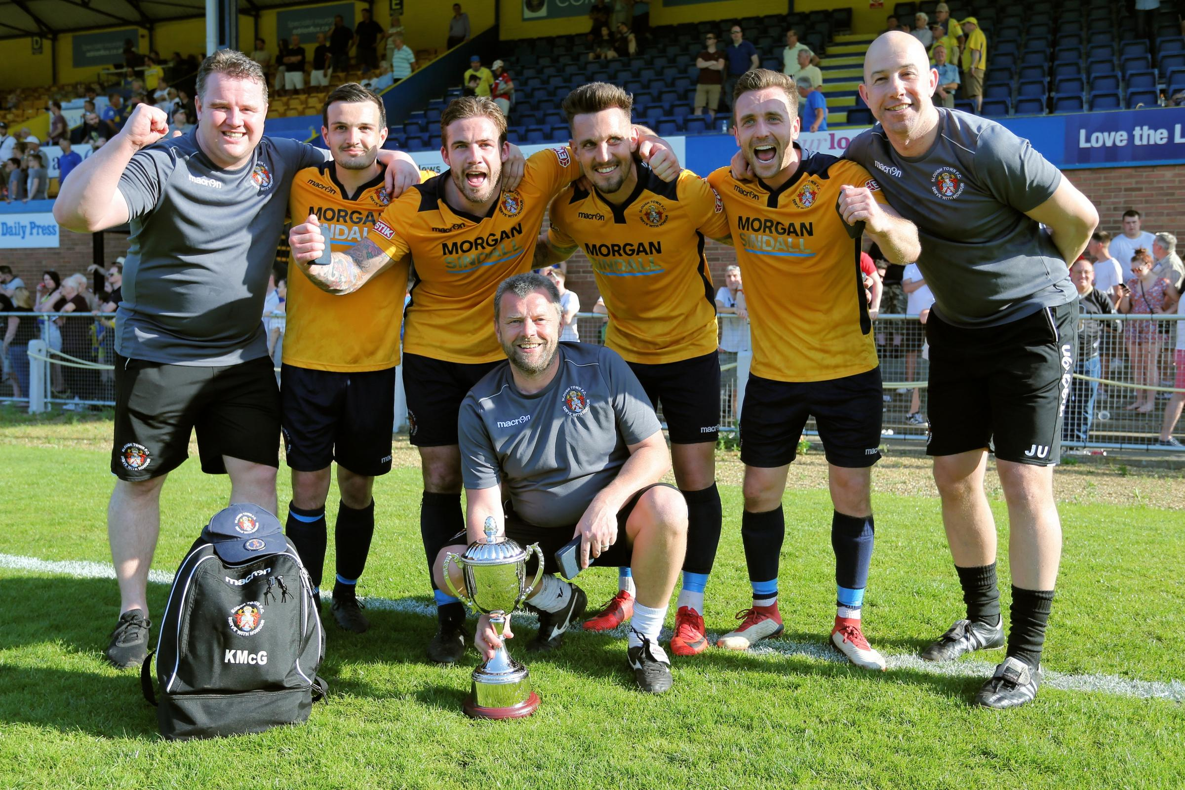 Slough Town joint-manager Jon Underwood (far right) celebrates with management and players plus the promotion play-off trophy. PHOTO: Gary House Photography.