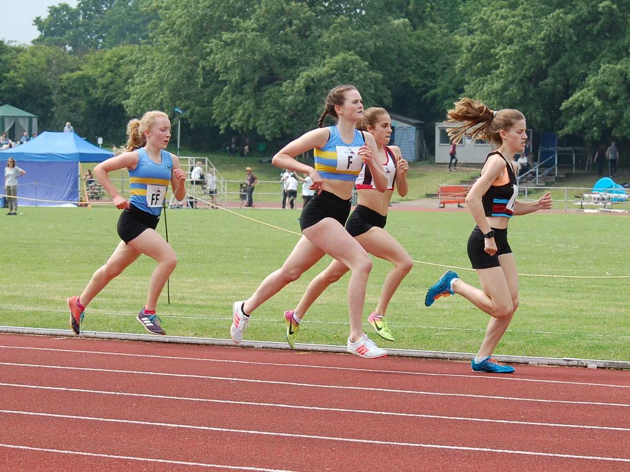 WSEH Athletics Club (blue vests) members Molly Jones (left) and Phoebe Anderson (right) in action during the Youth Development League Southern Premier series match at Bromley.