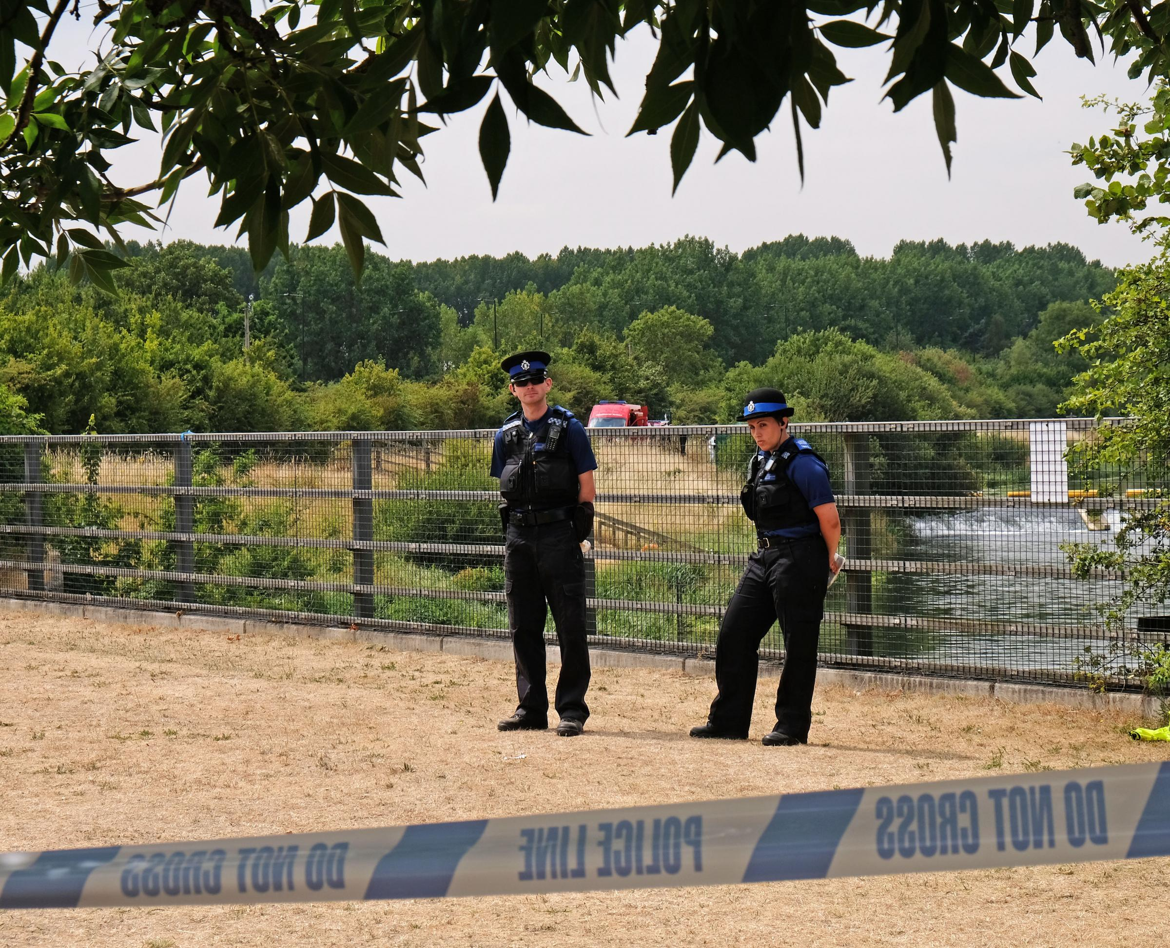PCSOs guard the closed Jubilee River path after Police divers recover the tragic teen's body – pic: Mike Swift