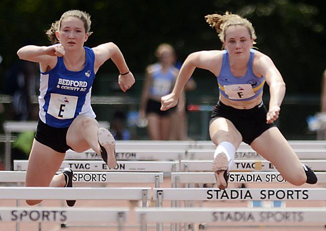 WSEH Athletics Club (blue with yellow hoops) member Ellie Cleveland (right) finished third in the opening U17 300m hurdles with  48.08 secs. PHOTOS: Paul Johns. Order code 1806101.