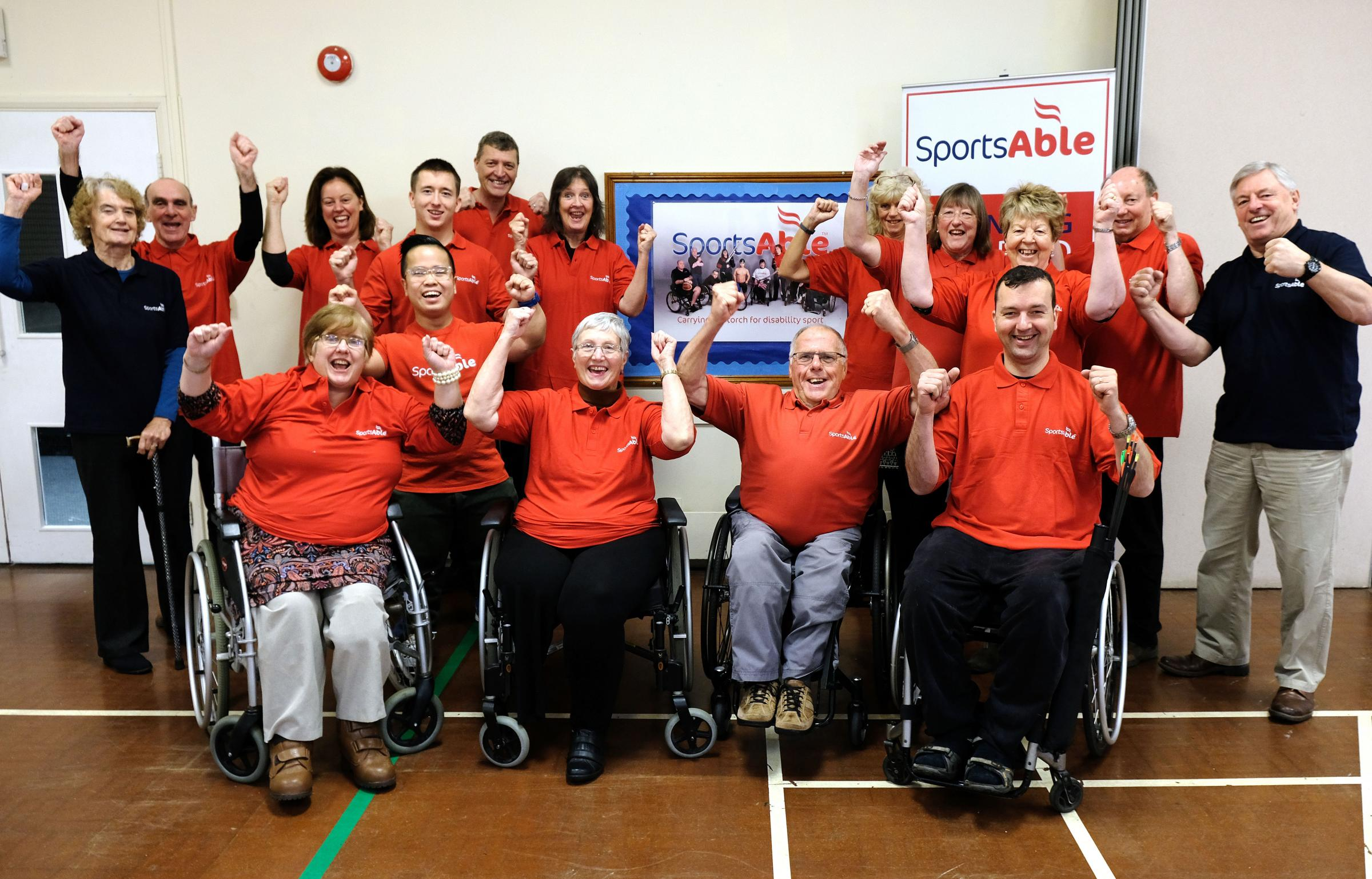 Staff, volunteers and users at SportsAble in a gala mood