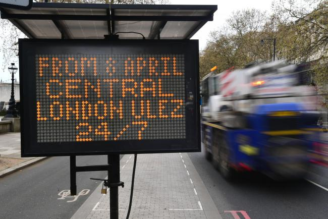 File photo of a sign near Embankment, central London, telling commuters that from April 8, there will an Ultra Low Emission Zone in place for 24 hours a day, seven days a week. Picture by Victoria Jones/PA Wire