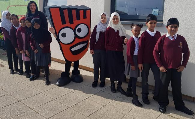 Strider with children from Iqra Primary School with assistant headteacher Pav Dhillon
